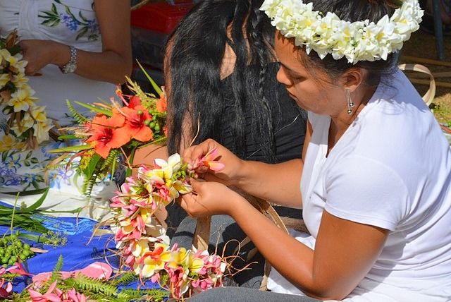 Young lady makes a flower crown Tapati Festival Easter Island