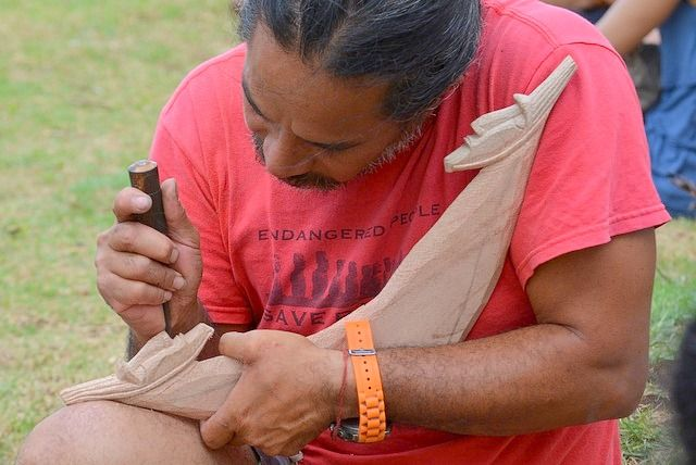 """A Rapanui artisan carves a wooden piece called """"reimiro"""" Tapati Festival Easter Island"""