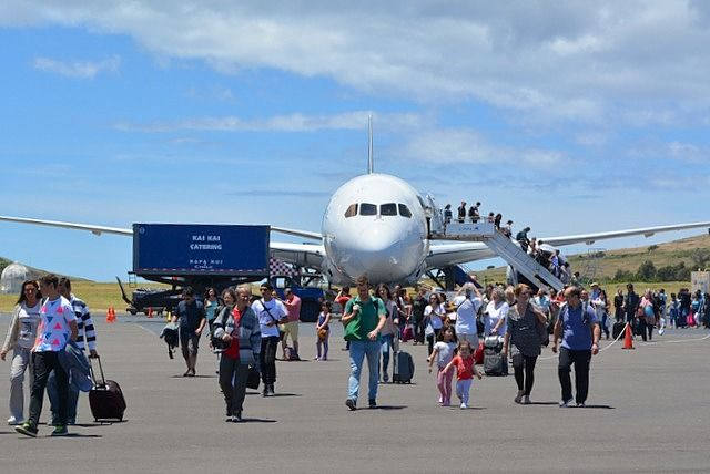 Passengers descending from LATAM Airlines plane at Mataveri airport, the Easter Island Airport Rapa Nui