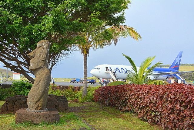 Classic image of the Manuel Tuki moai with the plane of Latam behind it Easter Island airport