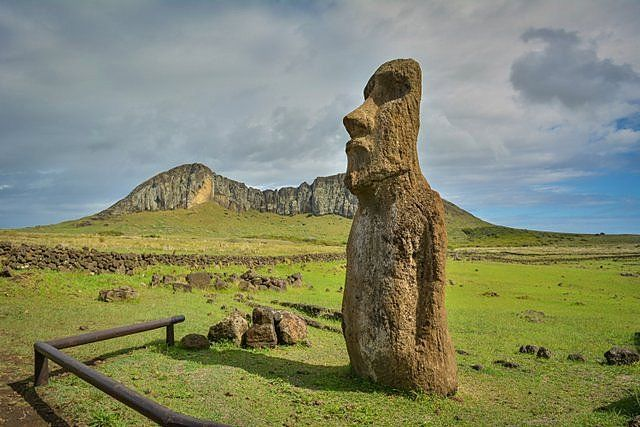 The traveling moai with the Rano Raraku volcano in the background