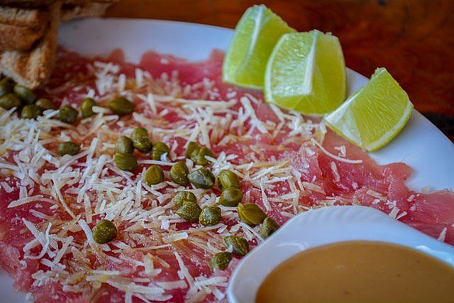 Tuna carpaccio with parmesan cheese and capers Easter Island Food
