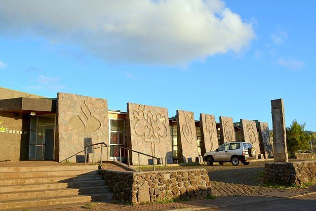 Facade with rapanui designs of Banco Santander in Hanga Roa Easter Island money and prices