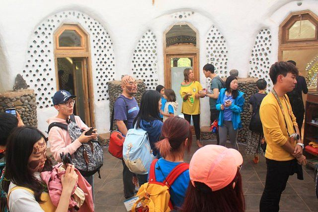 Tourists visiting the Toki Rapa Nui School of Music and Arts Easter Island